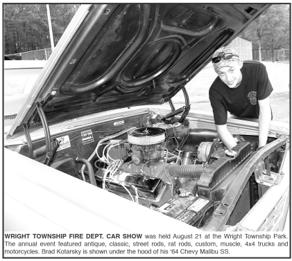 Brad Kotarsky is shown under the hood of his '64 Chevy Malibu SS.